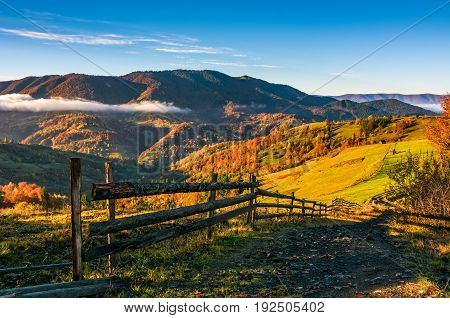 Wooden Fence By The Road In Rural Area