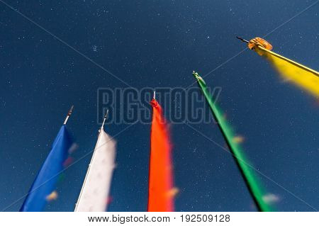Waving five colors of Tibetan prayer flags with stars in the night at Lachen in North Sikkim, India.