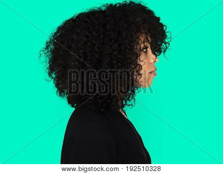 African girl casual studio portrait in side view
