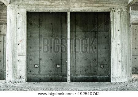 Empty concrete elevator shaft in abandoned building. Elevator shaft.