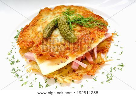 Potato pancake burger with ham and cheese. On a white background