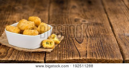 Chili Cheese Nuggets (selective Focus) On Vintage Wooden Background