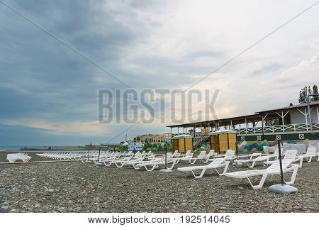 Sochi Krasnodar Krai Russia - June 06.2017: Deserted beach with sun loungers with a cloudy day. In anticipation of beach season