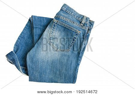 Blue denim jeans pants isolated on white background with copy space for text decoration folded fashion fabric textile pants for wearing