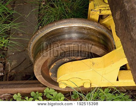 Wheel From A Vintage Cargo Wagon. Old Railway Wagon Of Forgotten Train In Railway Depot.