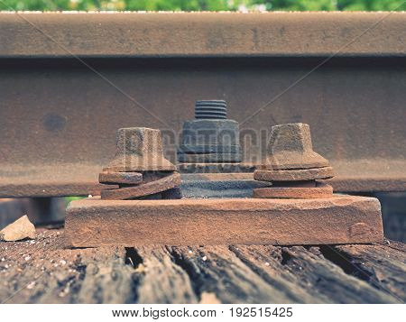 Detail Of Rusty Screws And Nut On Old Railroad Track. Rooten Wooden Tie With Rusty Nuts And Bolts.