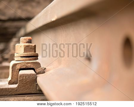 Selective Field Of Focus. Detail Of Rusty Screws And Nut On Old Railroad Track. Concrete Tie