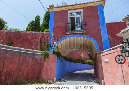 Small Colored House With Arc In Europe