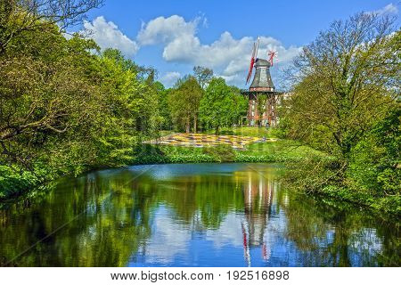 Mill in graan park and lake in Bremen, Germany