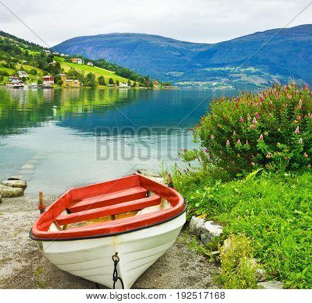 Boat on the beach, Norway fjords. Norwegian village Olden.