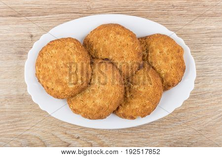 Oatmeal Cookies In Oval Dish On Wooden Table