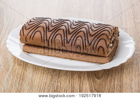 Striped Swiss Roll In Oval Dish On Table