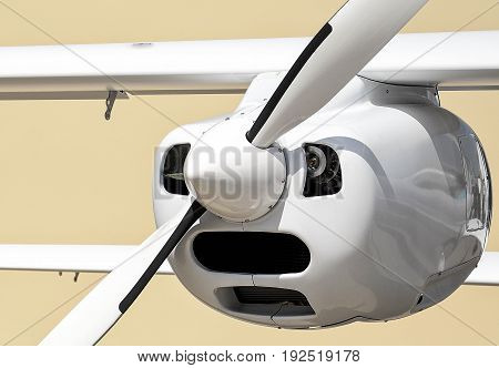 Small jet and white propeller close up