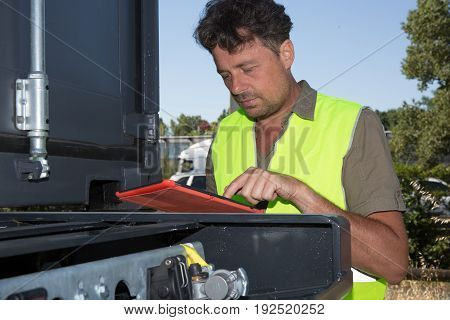 Mid Adult Businessman Holding Clipboard Tablet A Manual Worker Near Cargo Containers
