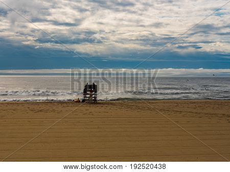 Lifeguards on an Empty Beach with the ocean churning after a summer squall