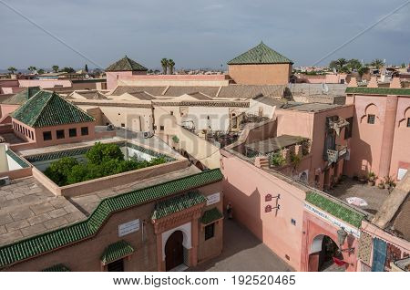 Marrakesh, Morocco - May 3, 2017: Roofs of mosque and madrasa of Ben Youssef view from neighbors roof. Marrakech Morocco