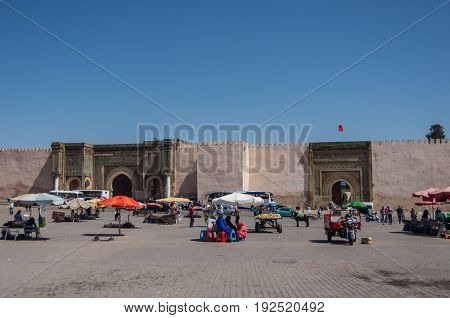 Meknes, Morocco - May 8, 2017: Lahdim Square of medieval imperial city of Meknes with Bab el Mansour gate at background Morocco.