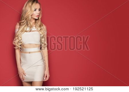 Beautiful Blonde Woman In Dress.