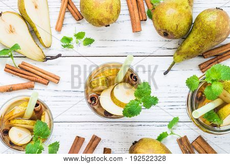 Refreshing Drink With Pear, Cinnamon On White Table. Top View