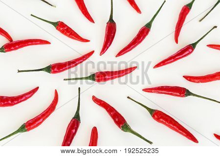 red hot chili peppers, popular spices, barbecue, food making concept - peppers filled white background, green tails, collage of freely lying peppers, top view, flat lay, horizontal