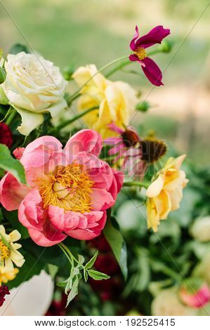 bouquet, holidays flower, gifts and floral arrangement concept - fresh colorful composition of pink peony, yellow and white roses, lilac daisies, stems and buds of summer flowers