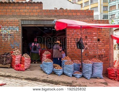 Indigenous people selling potatoes in La Paz Bolviia