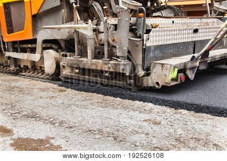 New asphalt road. Road asphalt works. Construction works