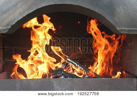 big brazier with burning fire prepared for cooking
