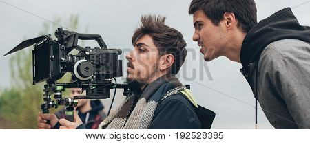 Behind The Scene. Cameraman And Film Director Shooting Film Scene