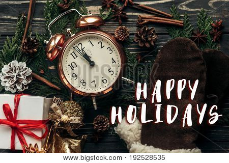 Happy Holidays Text Sign On Stylish Vintage Clock With Almost Twelve Hour And Presents Ornaments And