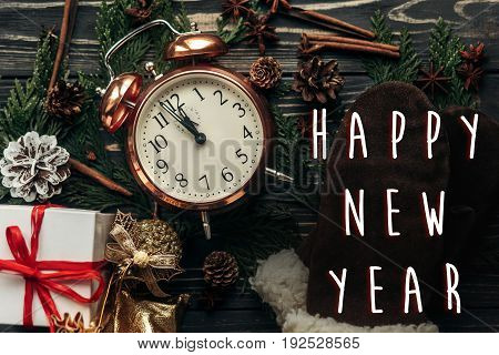 Happy New Year Text Sign Midnight Concept. Stylish Vintage Clock With Almost Twelve Hour And Present