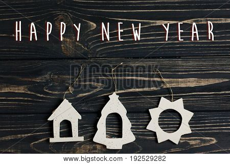 Happy New Year Text Sign On  Simple Christmas Eco Toys On Stylish Black Wooden Background. Space For