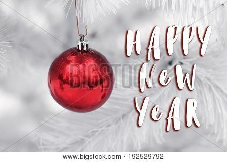 Happy New Year Text Sign On  Red Ornament Ball On White Christmas Tree Branches. Space For Text. Gre