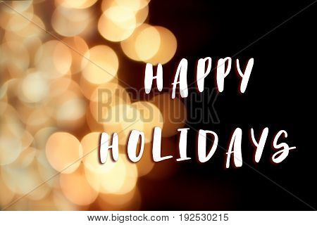Happy Holidays Text Sign On Christmas Garland Lights At Street In European City At Winter Seasonal H