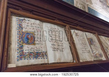 Italy Siena - December 26 2016: the view of the ancient books in biblioteca Piccolomini of Siena Cathedral on December 26 2016 in Siena Tuscany Italy.