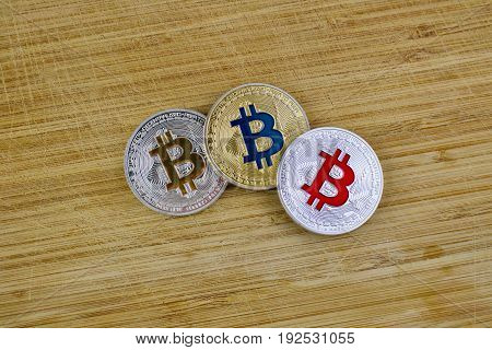 Bitcoins On Wooden Board