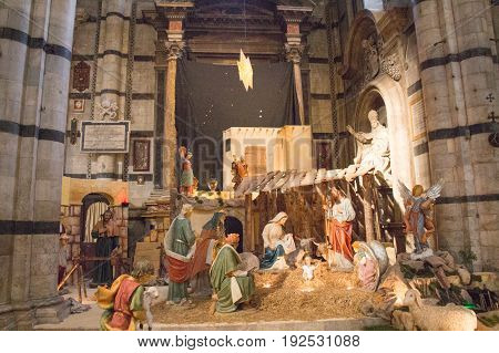 Italy Siena - December 26 2016: the view of traditional Christmas crib scenery in Duomo di Siena. Metropolitan Cathedral of Santa Maria Assunta on December 26 2016 in Siena Tuscany Italy.
