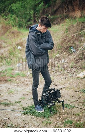 Behind The Scene. Cameraman Shooting Film Scene With His Camera