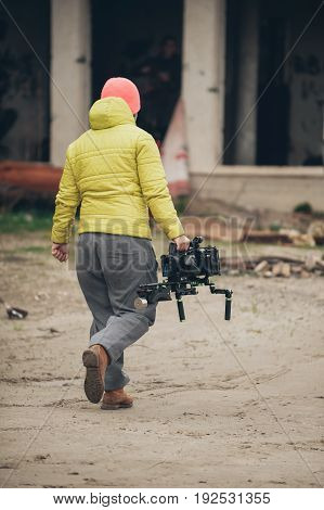 Behind The Scene. Cameraman With His Camera