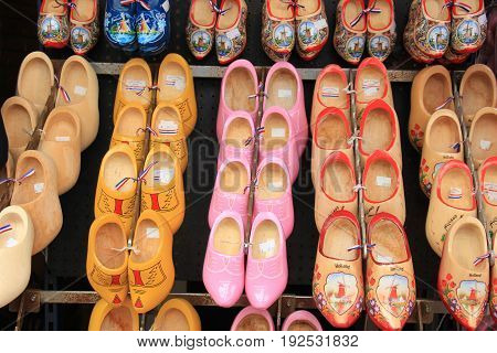 Colorful painted clogs the traditional Dutch wooden shoes in a tourist shop