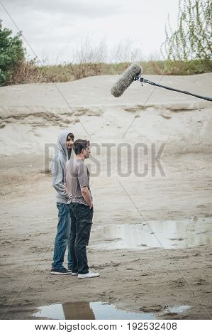 Behind The Scene. Two Actors In Front Of Boom Microphone