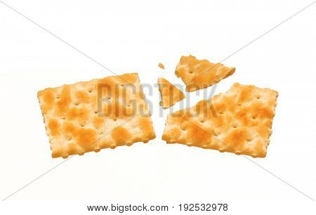 Broken crispy cracker soda on white background