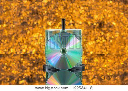 Stacks Of 50 Cd / Dvd In Orange Background Defocused