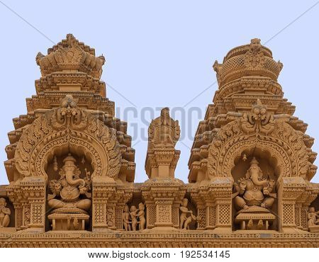 Nanjangud India - October 26 2013: Double Niche in beige elaborately decorated sandstone at Srikanteshwara Temple showing both statue of sitting Lord Ganesha. Sexual imagery nearby.