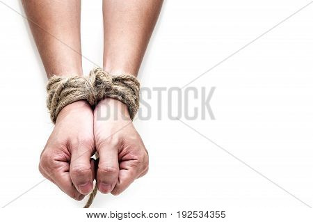victim slave prosoner male hands tied by big rope isolated on the white background. People have no freedom concept image.