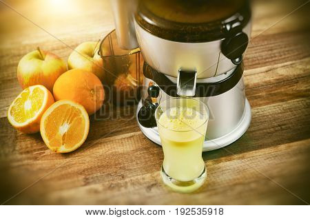 Juicer prepares fresh and healthy juice. juicer juice extractor fresh blender machine concept
