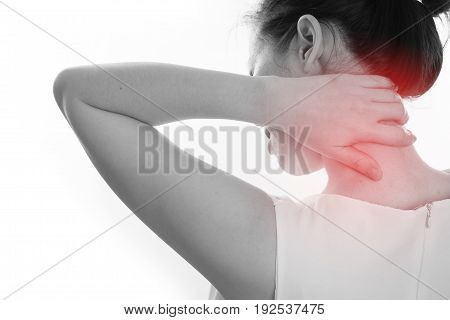 young woman having neck pain on isolated white background. concept of office syndrome. view from back body.