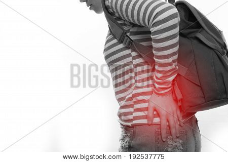 young asian woman having and touch hip pain on isolated white background.