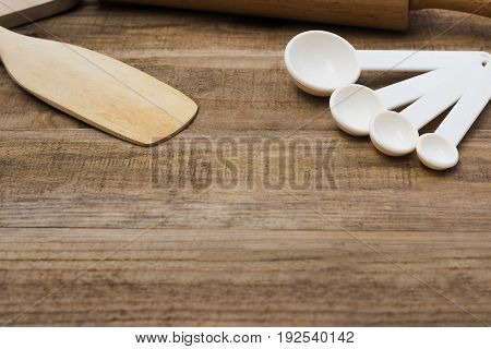 Wood bakery tool and Oz spoon on wood table