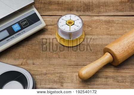 Bakery And Cooking Tools With Kitchen Timer, Scales, Kitchen Mold On Wood Table